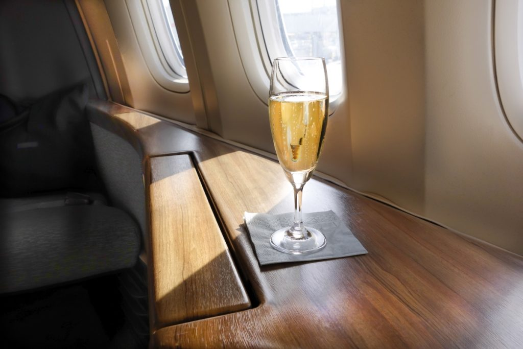 Glass of champagne on a flight